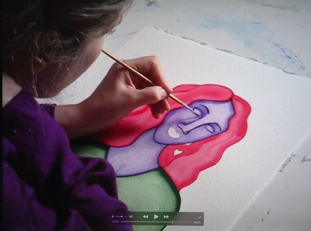 video still of Rita painting